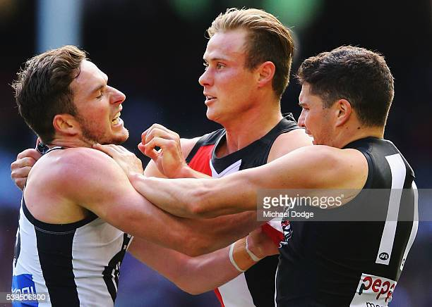 David Armitage of the Saints and Leigh Montagna wrestle with Jed Lamb of the Blues during the round 12 AFL match between the St Kilda Saints and the...