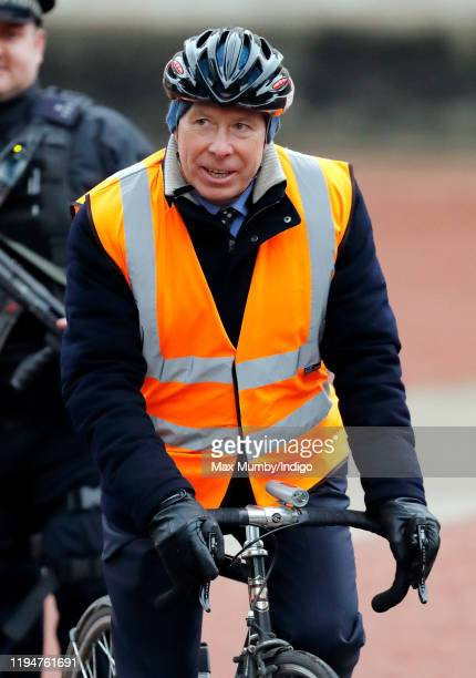 David ArmstrongJones 2nd Earl of Snowdon departs on a bicycle after attending a Christmas lunch for members of the Royal Family hosted by Queen...
