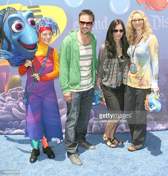 David Arquette Courteney Cox and Lisa Kudrow during Finding Nemo Submarine Voyage Opening Arrivals at Disneyland in Anaheim California United States