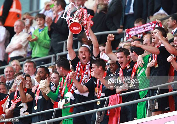 David Artell of Crewe Alexandra lifts the trophy during the npower League Two Playoff Final match between Cheltenham Town and Crewe Alexandra at...