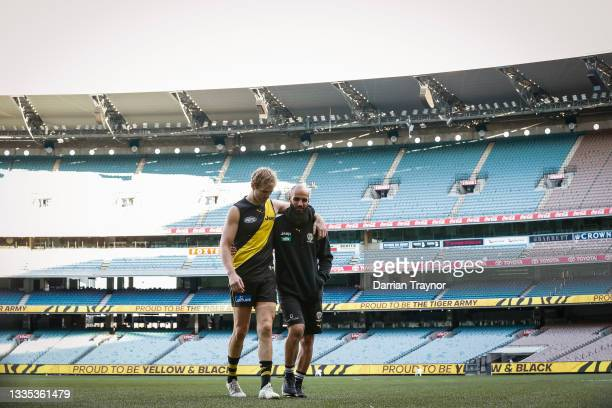 David Astbury and Bachar Houli of the Tigers take one last walk on the M.C.G. As Richmond player after the round 23 AFL match between Richmond Tigers...