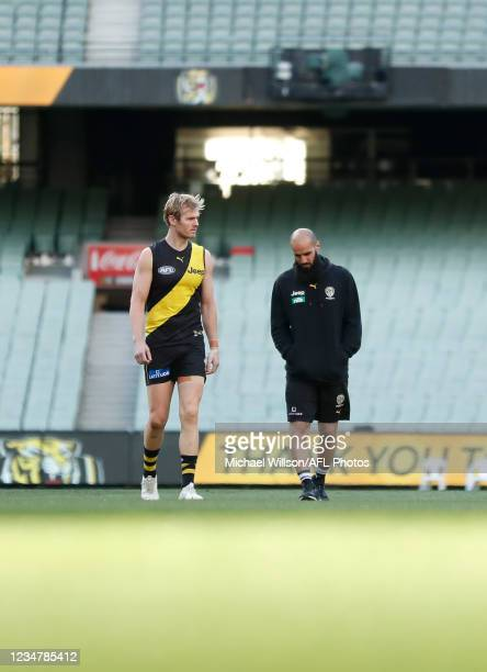 David Astbury and Bachar Houli of the Tigers walk onto the field after the 2021 AFL Round 23 match between the Richmond Tigers and the Hawthorn Hawks...