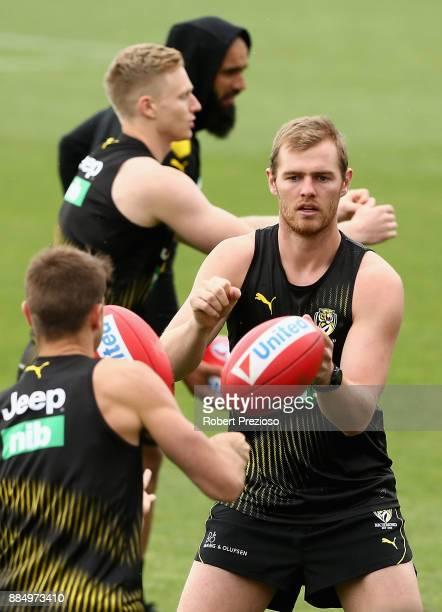 David Astbury handballs during a Richmond Tigers AFL training session at Punt Road Oval on December 4 2017 in Melbourne Australia