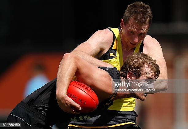 David Astbury is tackled by teammate Dylan Grimes during a Richmond Tigers AFL preseason training session at the ME Bank Centre on November 21 2016...