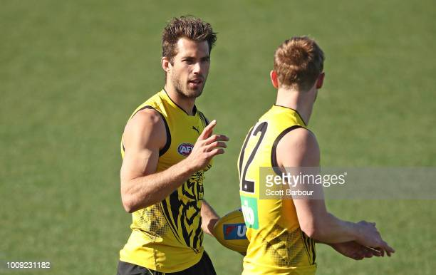 David Astbury of the Tigers and Alex Rance of the Tigers talk during a Richmond Tigers AFL training session at Punt Road Oval on August 2 2018 in...