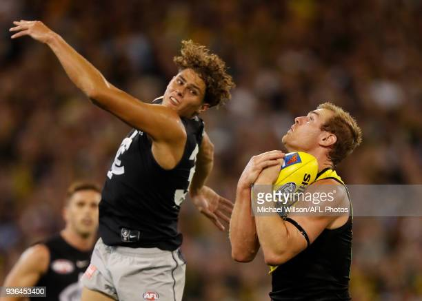 David Astbury of the Tigers and Charlie Curnow of the Blues compete for the ball during the 2018 AFL round 01 match between the Richmond Tigers and...