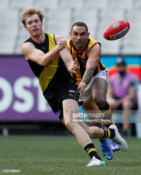 David Astbury of the Tigers and Shaun Burgoyne of the Hawks in action during the 2021 AFL Round 23 match between the Richmond Tigers and the Hawthorn...