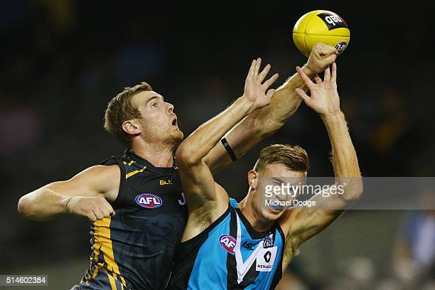 David Astbury of the Tigers competes for the ball against Dougal Howard of the Power during the 2016 AFL NAB Challenge match between the Richmond...