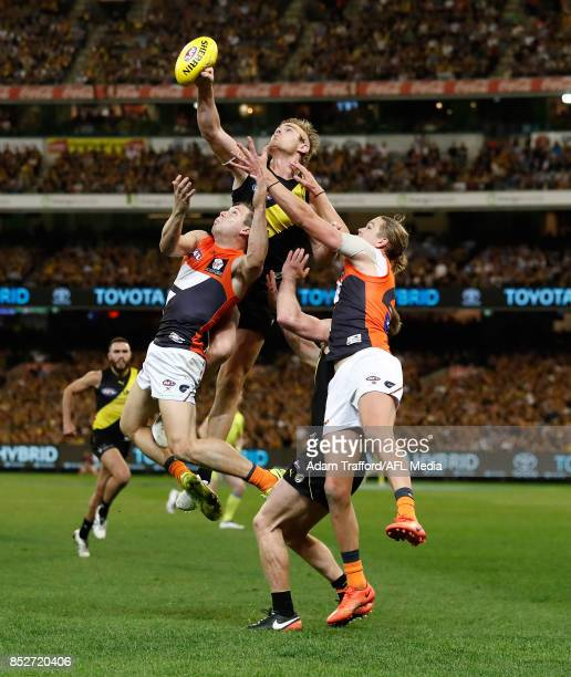 David Astbury of the Tigers competes for the ball with Toby Greene and Harrison Himmelberg11 of the Giants during the 2017 AFL Second Preliminary...
