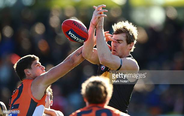 David Astbury of the Tigers contests a mark during the round 19 AFL match between the Greater Western Sydney Giants and the Richmond Tigers at Star...