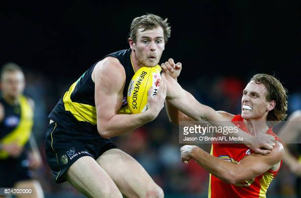 David Astbury of the Tigers in action during the round 19 AFL match between the Gold Coast Suns and the Richmond Tigers at Metricon Stadium on July...