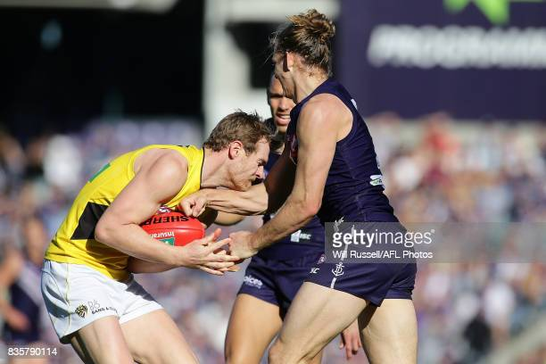 David Astbury of the Tigers marks the ball during the round 22 AFL match between the Fremantle Dockers and the Richmond Tigers at Domain Stadium on...