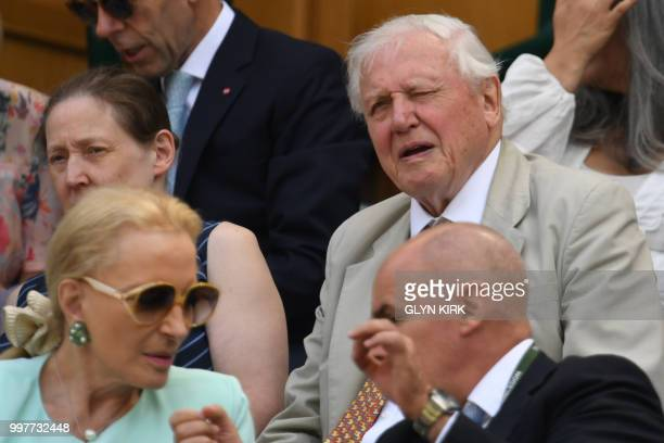 David Attenborough sits in the Royal box on Centre Court to watch US player John Isner play South Africa's Kevin Anderson during their men's singles...