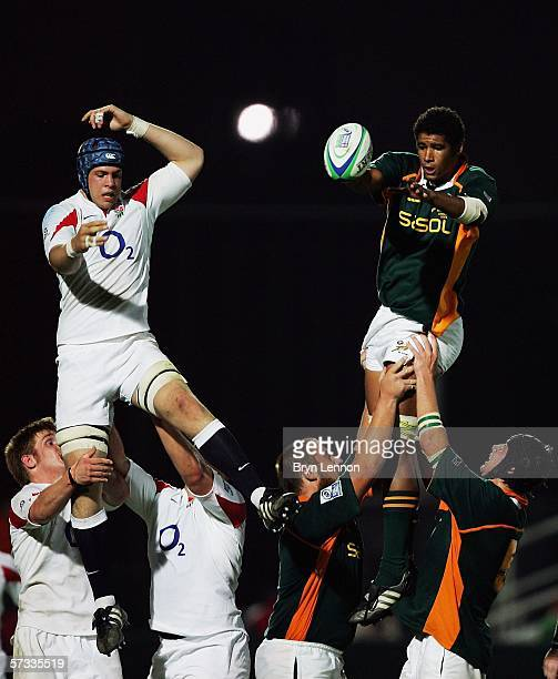 David Attwood of England and Malungisa Nkosi of South Africa contest a lineout during the IRB Under 19s World Championship Pool A game between South...