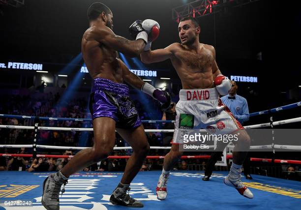 David Avanesyan right attempts to hit Lamont Peterson left during their Welterweight Championship fight on February 18 2017 in Cincinnati Ohio