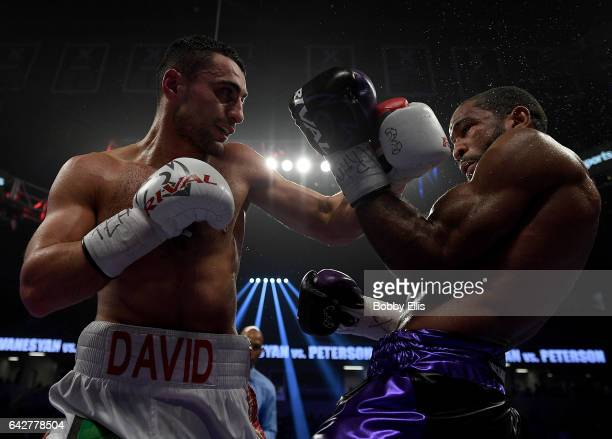 David Avaneysan left hits Lamont Peterson right during their Welterweight Championship fight on February 18 2017 in Cincinnati Ohio