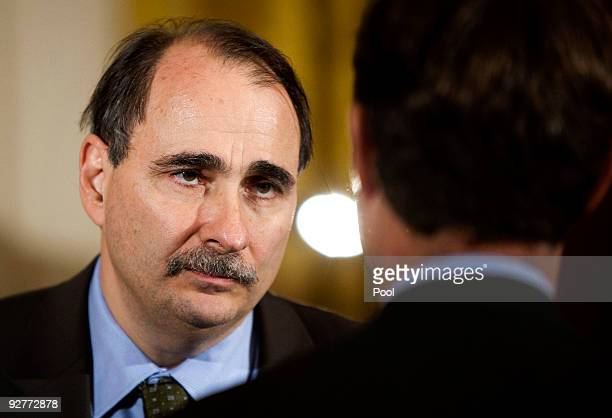 David Axelrod White House senior advisor speaks to a guest at an event hosted by US President Barack Obama and first lady Michelle Obama celebrating...
