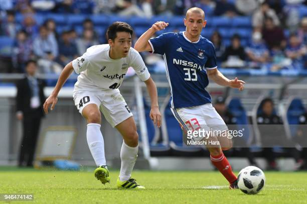 David Babunski of Yokohama FMarinos and Yuki Kobayashi of Vissel Kobe compete for the ball during the JLeague J1 match between Yokohama FMarinos and...