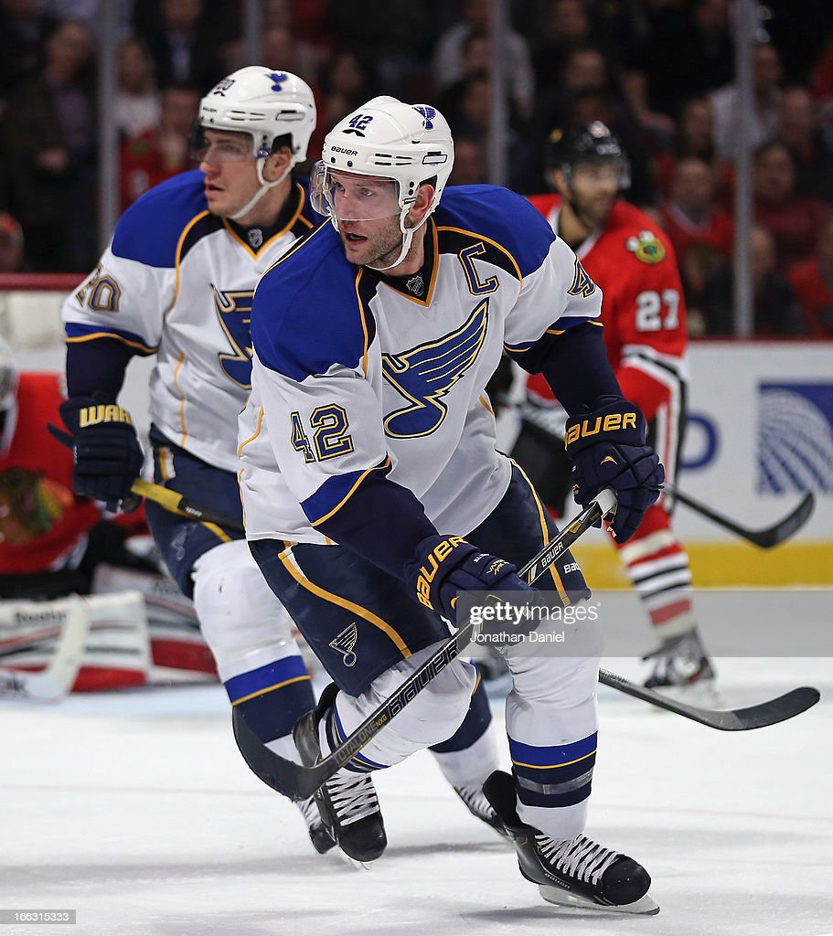 David Backes #42 and Alexander Steen #20 of the St. Louis Blues turn to the puck against the Chicago Blackhawks at the United Center on April 4, 2013 in Chicago, Illinois. The Blues defeated the Blackhawks 4-3 in a shootout.