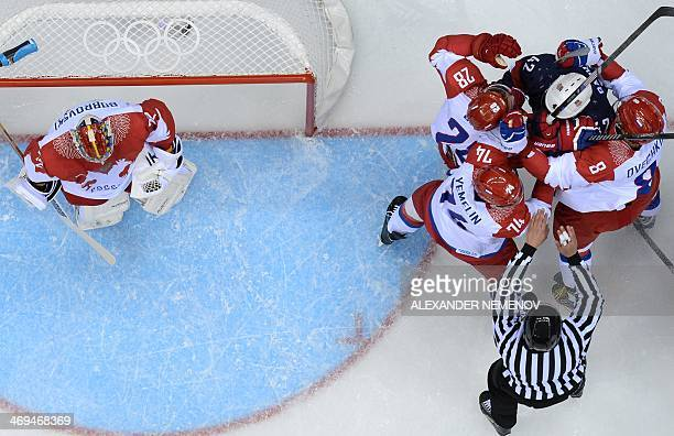 US David Backes fights with Russia's Alexei Yemelin Russia's Alexander Ovechkin and Russia's Alexander Syomin during the Men's Ice Hockey Group A...