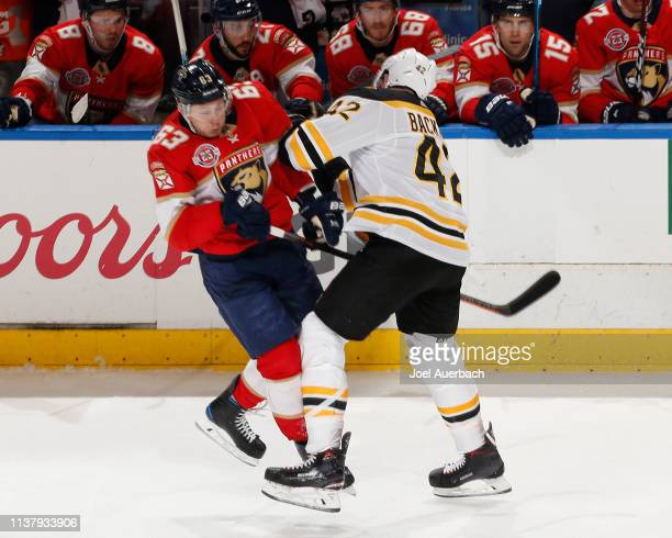 David Backes of the Boston Bruins and Evgenii Dadonov of the Florida Panthers come together during third period action at the BBT Center on March 23...