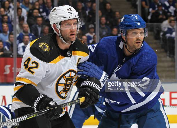 David Backes of the Boston Bruins battles against Ron Hainsey of the Toronto Maple Leafs in Game Three of the Eastern Conference First Round during...