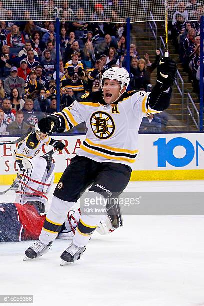 David Backes of the Boston Bruins celebrates after Brad Marchand of the Boston Bruins scores a goal during the game against the Columbus Blue Jackets...