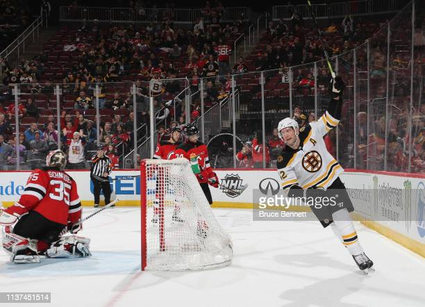 David Backes of the Boston Bruins celebrates his goal at 1938 of the third period against Cory Schneider of the New Jersey Devils at the Prudential...