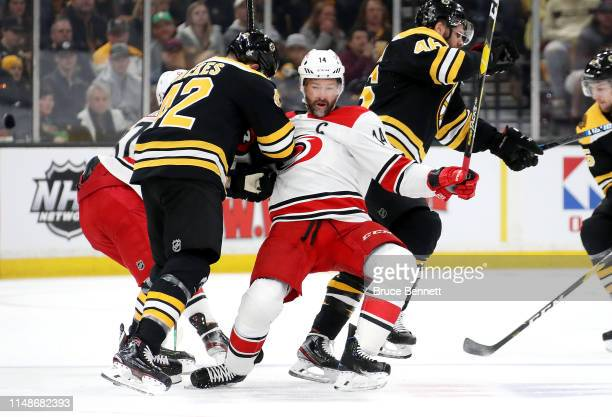 David Backes of the Boston Bruins checks Justin Williams of the Carolina Hurricanes during the first period in Game Two of the Eastern Conference...