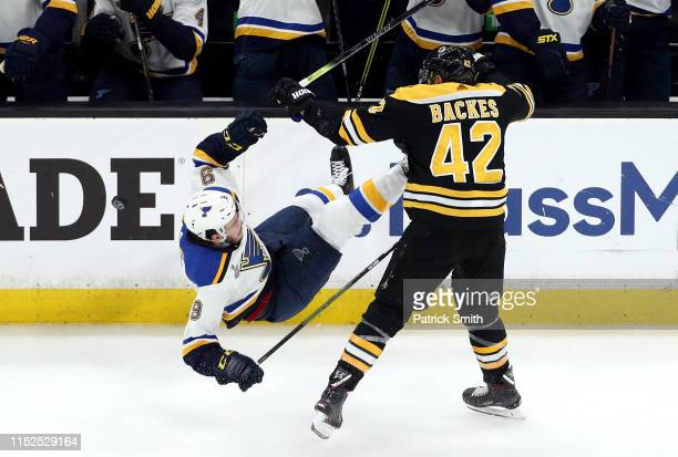 David Backes of the Boston Bruins checks Sammy Blais of the St Louis Blues during the second period in Game Two of the 2019 NHL Stanley Cup Final at...