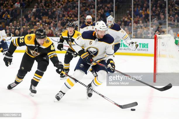 David Backes of the Boston Bruins defends Marco Scandella of the Buffalo Sabres during the third period at TD Garden on January 05 2019 in Boston...