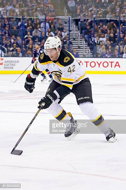 David Backes of the Boston Bruins skates after the puck during the game against the Columbus Blue Jackets on October 13 2016 at Nationwide Arena in...