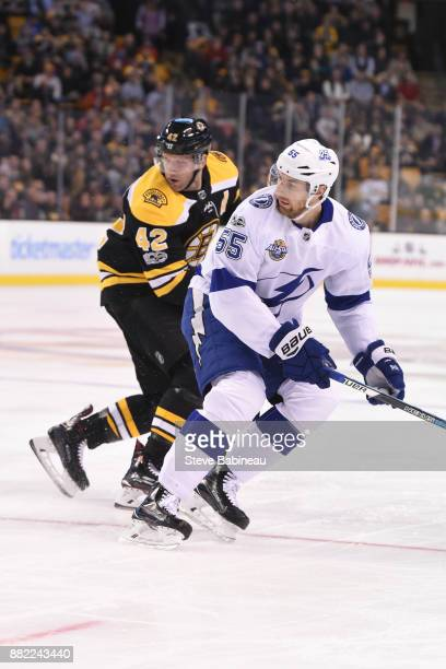 David Backes of the Boston Bruins skates against Brayden Coburn of the Tampa Bay Lightning at the TD Garden on November 29 2017 in Boston...