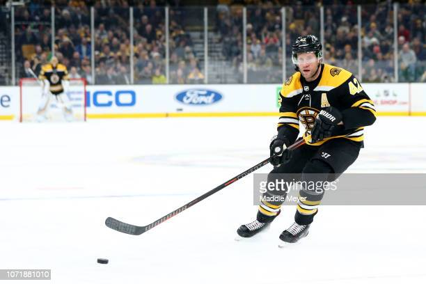 David Backes of the Boston Bruins skates against the Arizona Coyotes during the third period at TD Garden on December 11 2018 in Boston Massachusetts...
