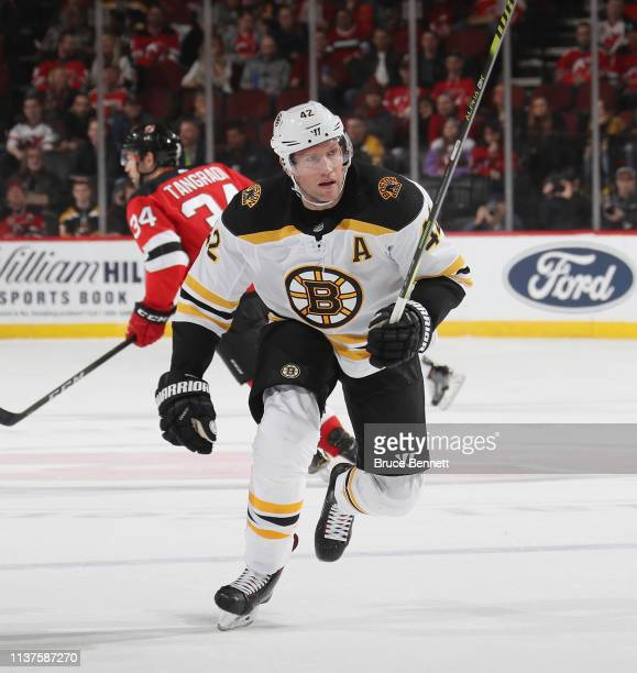 David Backes of the Boston Bruins skates against the New Jersey Devils at the Prudential Center on March 21 2019 in Newark New Jersey The Bruins...
