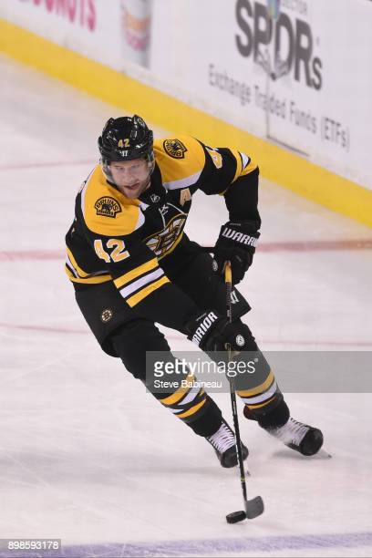 David Backes of the Boston Bruins skates with the puck against the Detroit Red Wings at the TD Garden on December 23 2017 in Boston Massachusetts