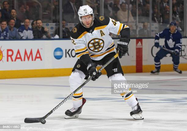 David Backes of the Boston Bruins skates with the puck against the Toronto Maple Leafs in Game Three of the Eastern Conference First Round during the...