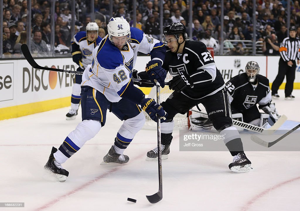 David Backes #42 of the St. Louis Blues and Dustin Brown #23 of the Los Angeles Kings fight for the puck in the first period of Game Six of the Western Conference Quarterfinals during the 2013 NHL Stanley Cup Playoffs at Staples Center on May 10, 2013 in Los Angeles, California.
