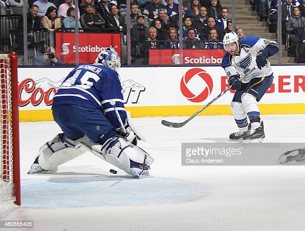 David Backes of the St Louis Blues beats Jonathan Bernier of the Toronto Maple Leafs for a goal during an NHL game at the Air Canada Centre on March...