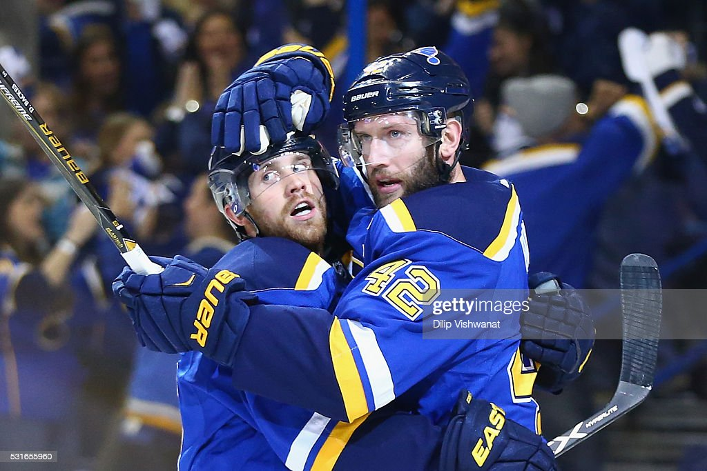 David Backes #42 of the St. Louis Blues (R) celebrates with Jaden Schwartz #17 after scoring a first period goal against Martin Jones #31 of the San Jose Sharks (not pictured) in Game One of the Western Conference Final during the 2016 NHL Stanley Cup Playoffs at Scottrade Center on May 15, 2016 in St Louis, Missouri.