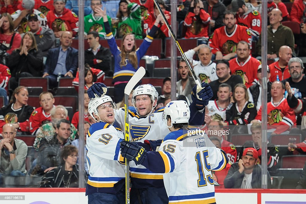 David Backes #42 of the St. Louis Blues (center) celebrates with Scottie Upshall #10 and Robby Fabbri #15 after scoring and tying the game in the second period of the NHL game against the Chicago Blackhawks at the United Center on November 4, 2015 in Chicago, Illinois.