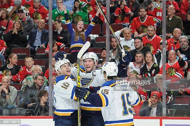 David Backes of the St Louis Blues celebrates with Scottie Upshall and Robby Fabbri after scoring and tying the game in the second period of the NHL...