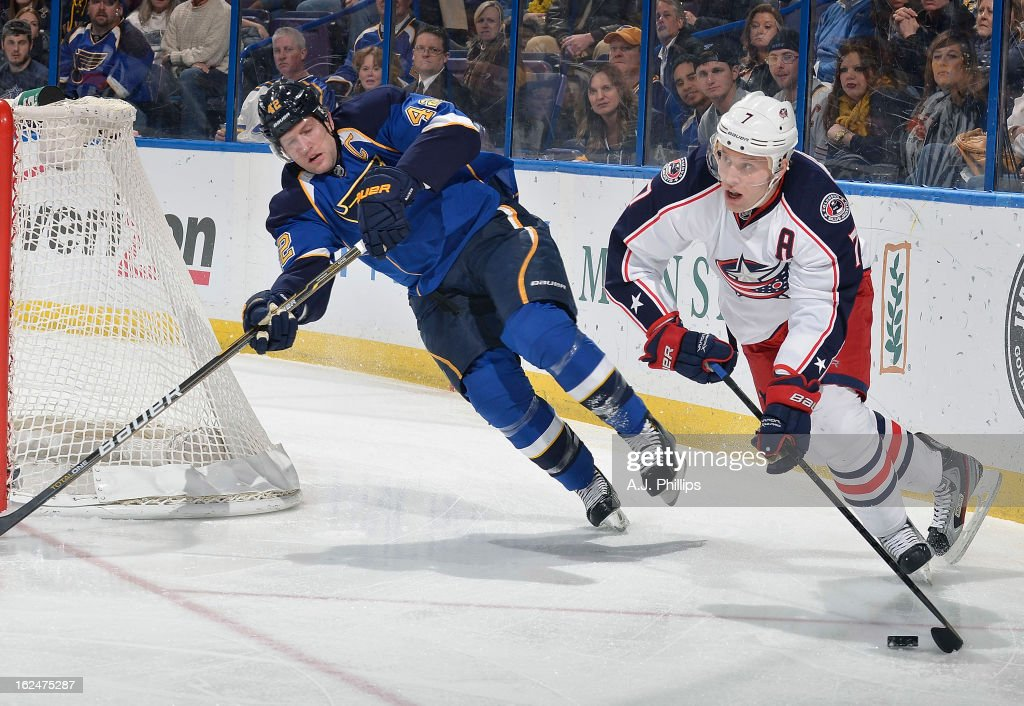 David Backes #42 of the St. Louis Blues pursues Jack Johnson #7 of the Columbus Blue Jackets as he controls the puck in an NHL game on February 23, 2013 at Scottrade Center in St. Louis, Missouri.