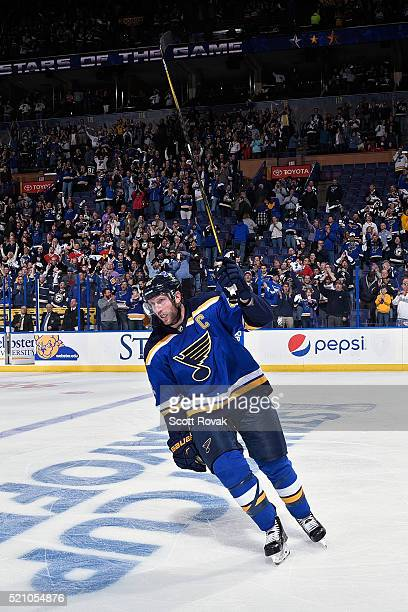 David Backes of the St Louis Blues salutes the fans after scoring the game winning goal against the Chicago Blackhawks during overtime in Game One of...