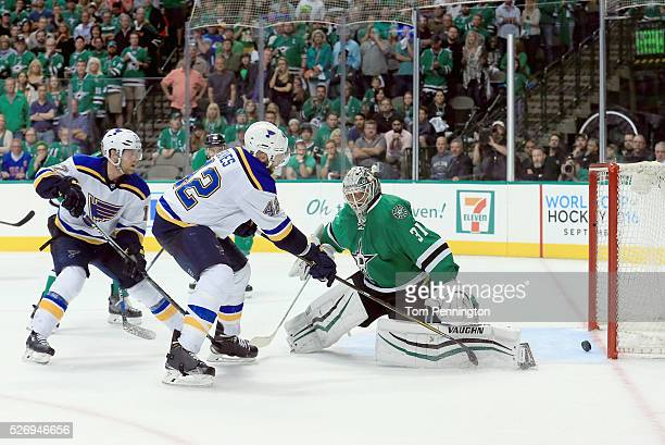 David Backes of the St Louis Blues scores the game winning goal against Antti Niemi of the Dallas Stars in overtime in Game Two of the Western...