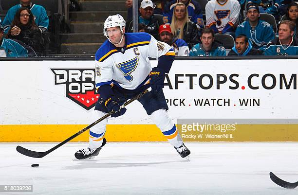 David Backes of the St Louis Blues skates with the puck against the San Jose Sharks at SAP Center on March 22 2016 in San Jose California