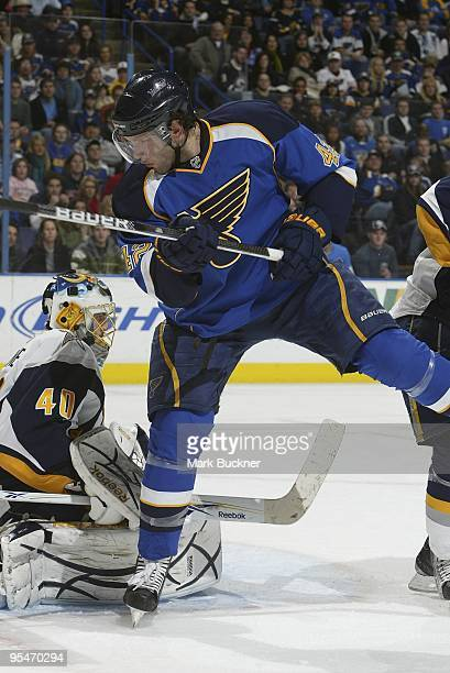 David Backes of the St. Louis Blues takes a shot on Patrick Lalime of the Buffalo Sabres on December 27, 2009 at Scottrade Center in St. Louis,...