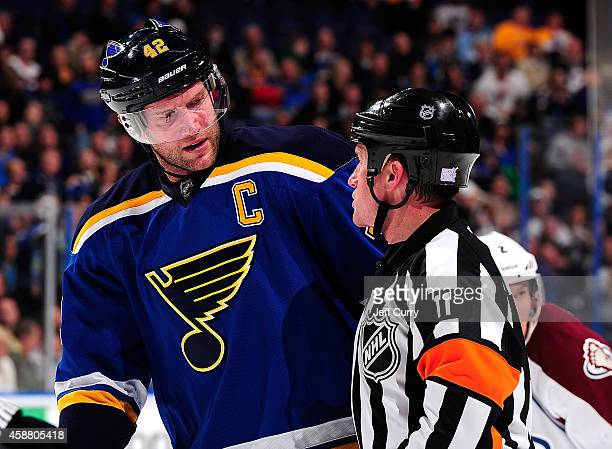 David Backes of the St Louis Blues talks with referee Kelly Sutherland during a game against the Colorado Avalanche on November 1 2014 at Scottrade...