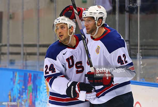 David Backes of the United States celebrates after scoring a goal with Ryan Callahan against Slovenia in the third period during the Men's Ice Hockey...