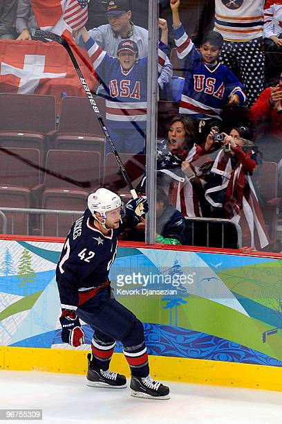 David Backes of the United States reacts after he scored a goal in the second period against Switzerland during the ice hockey men's preliminary game...